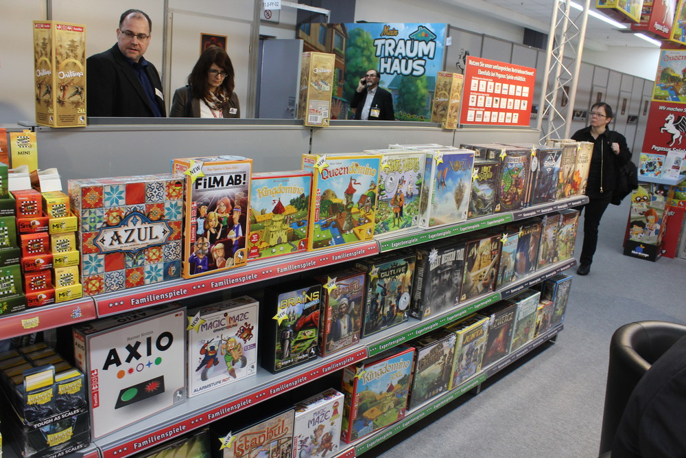 Shelves of goodness - Pegasus Spiele showing off some of their great titles